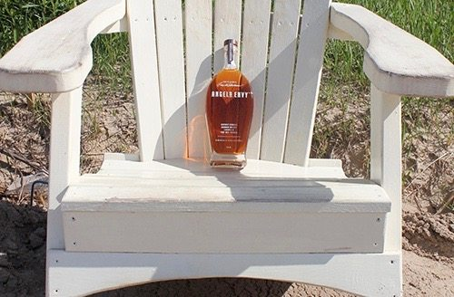 AE Bottle on adirondack chair