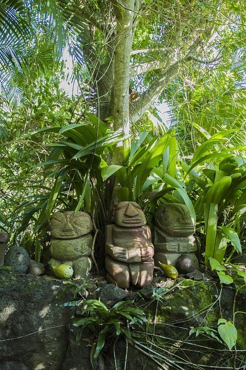 Tiki totems in garden