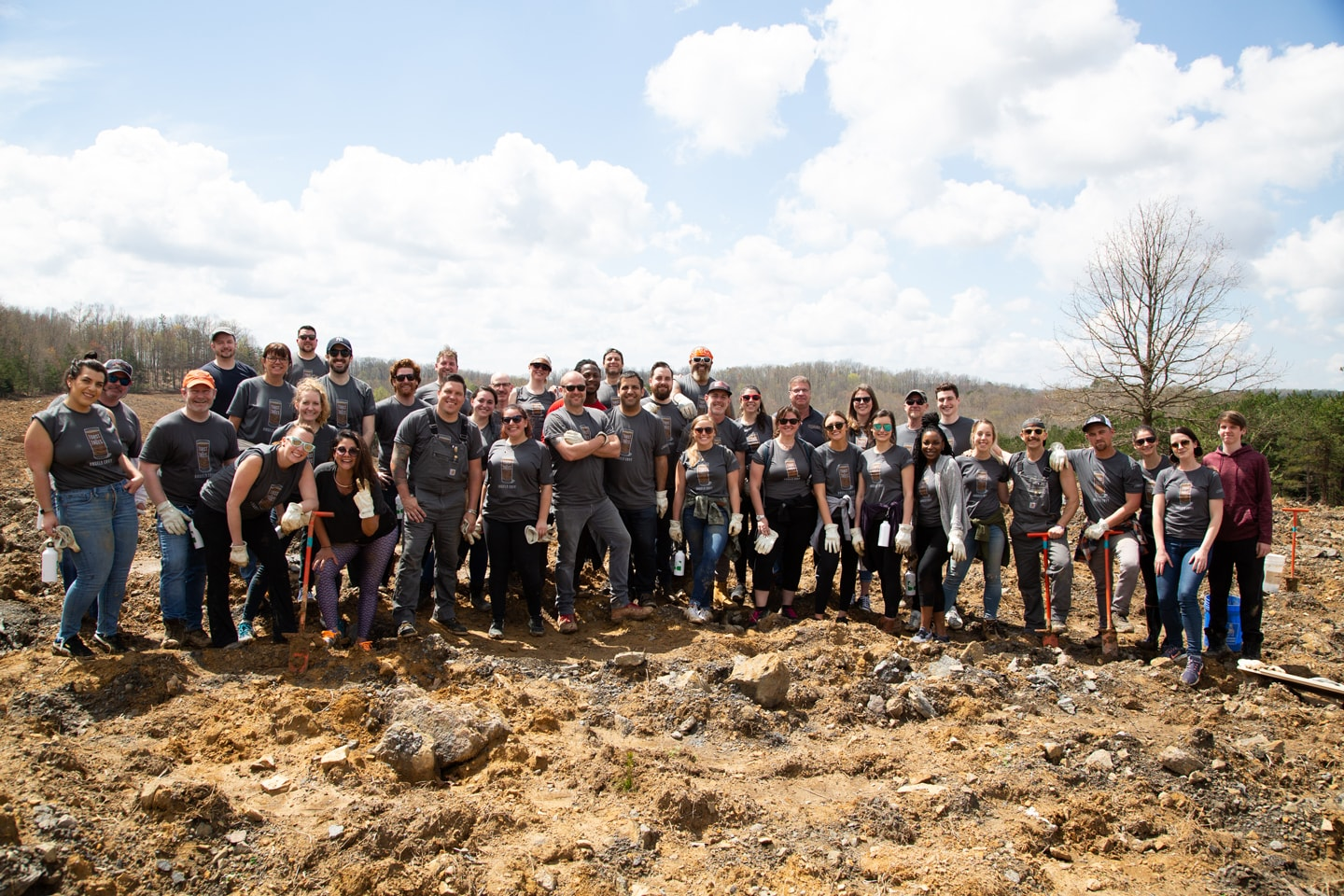 Angel's Envy Team planting oak trees for Toast the Trees